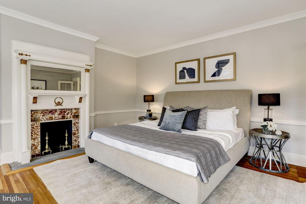 Bedroom with a wood-burning fireplace. - 3029 O ST NW, WASHINGTON