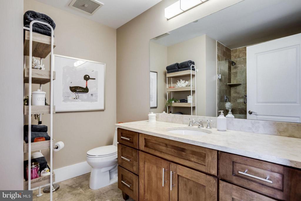 Travertine tiles in the luxurious master bathroom - 1600 CLARENDON BLVD #W413, ARLINGTON