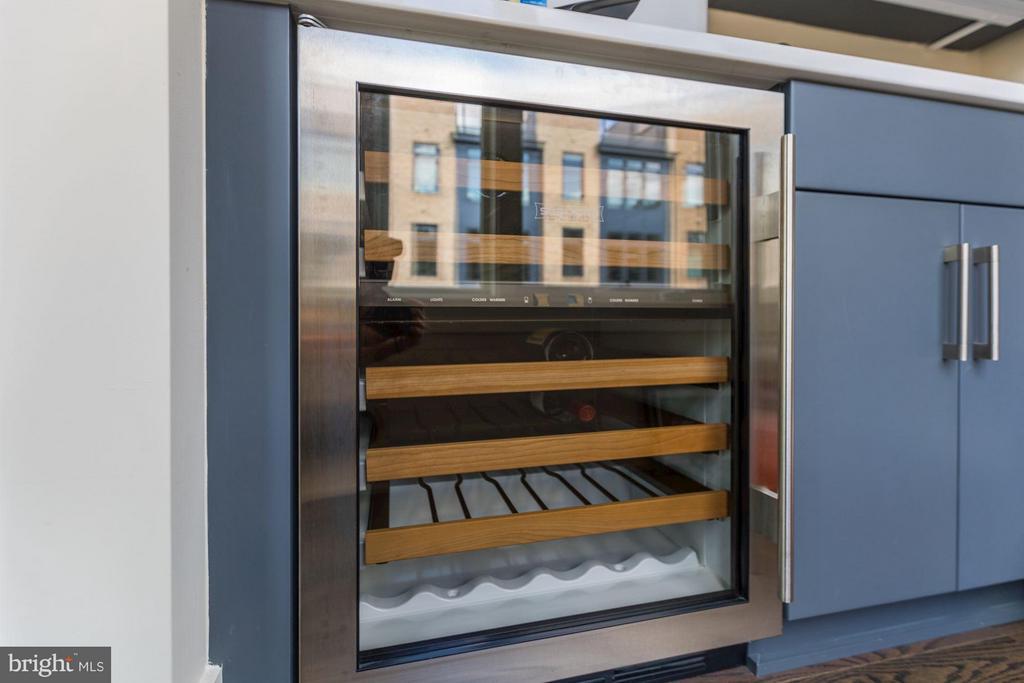 Built-in wine refrigerator in wet bar area - 171 WINSOME CIR, BETHESDA