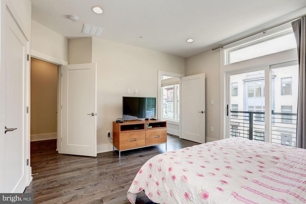 Master bedroom with doors to balcony - 171 WINSOME CIR, BETHESDA