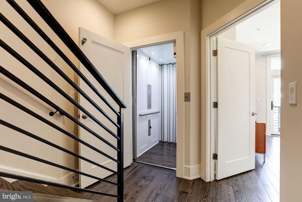 Hallway leading into elevator - 171 WINSOME CIR, BETHESDA