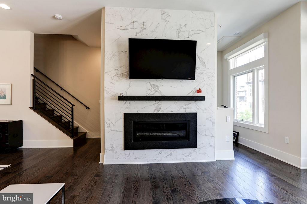 Upgraded fireplace with marble surround - 171 WINSOME CIR, BETHESDA
