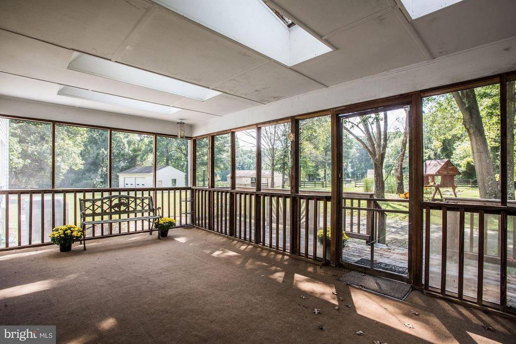 Back sun porch over looking pond and fields. - 15781 PALMER LN, HAYMARKET