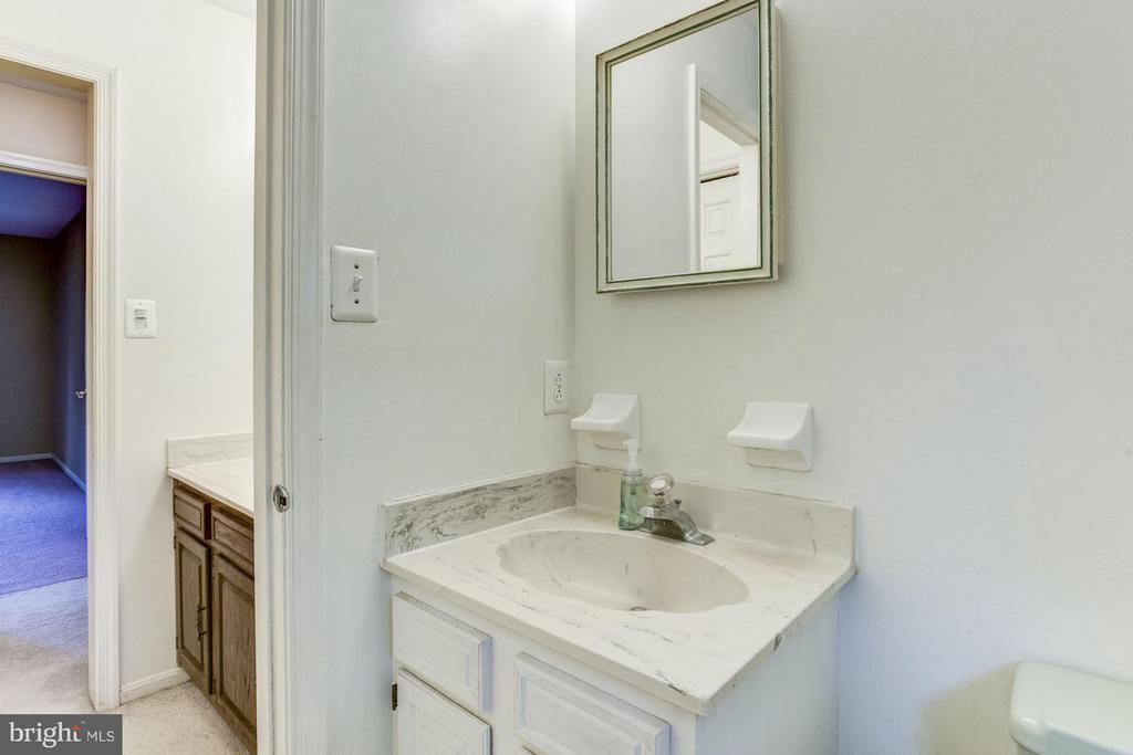 Second bathroom and dressing area. - 15781 PALMER LN, HAYMARKET