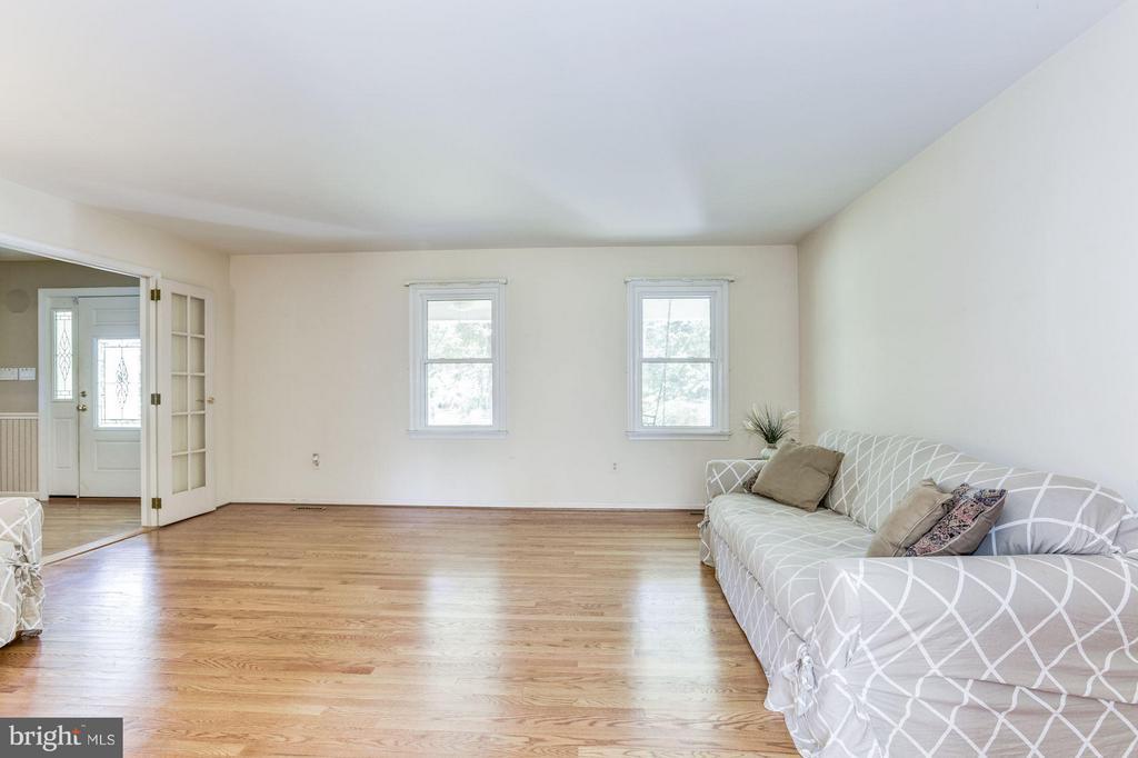 Formal living with ceiling height French doors - 15781 PALMER LN, HAYMARKET