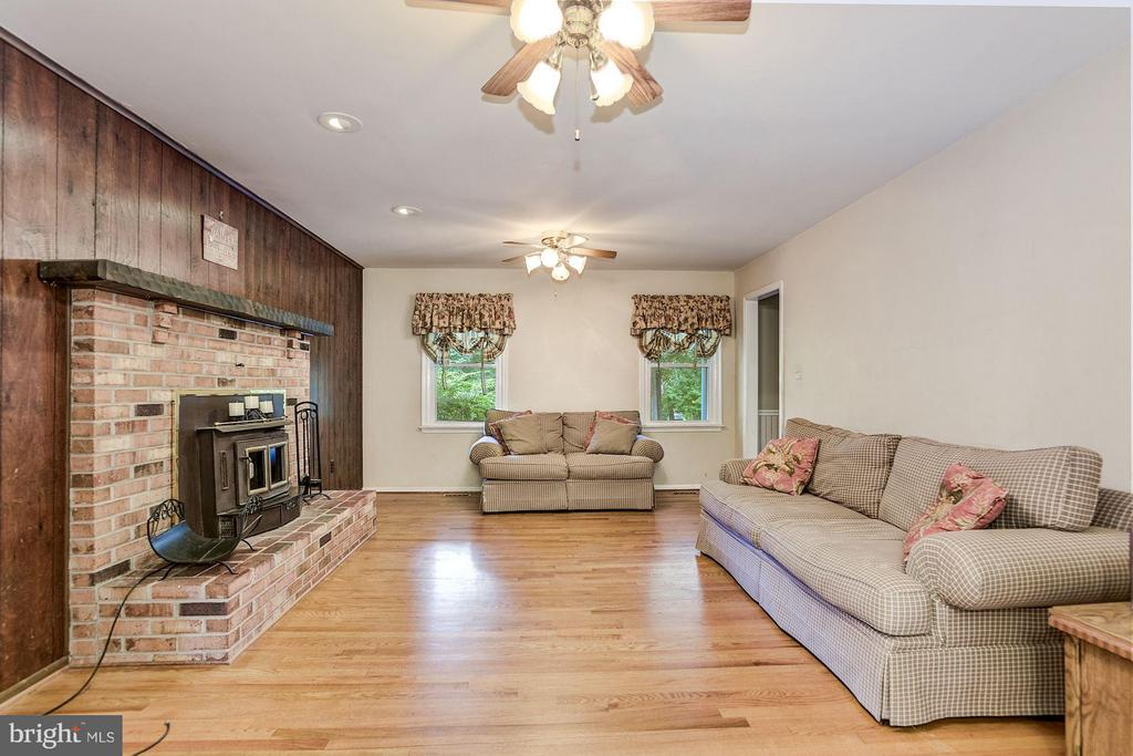 Family Room with wood burning stove - 15781 PALMER LN, HAYMARKET