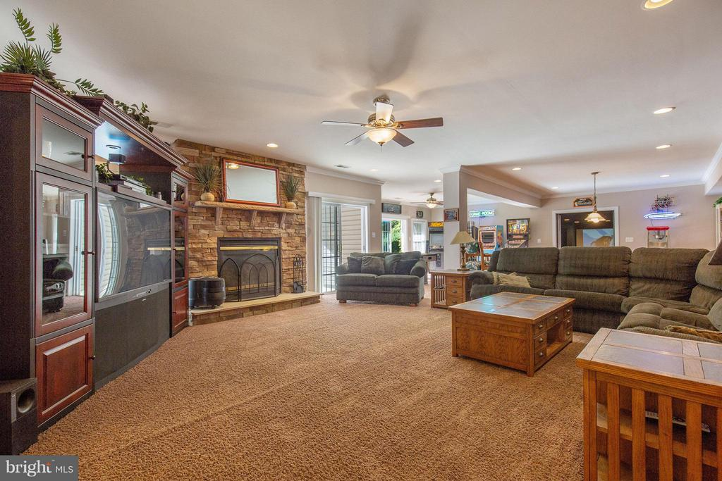 Incredible lower level family room with fireplace. - 170 BALL RD, SAINT LEONARD