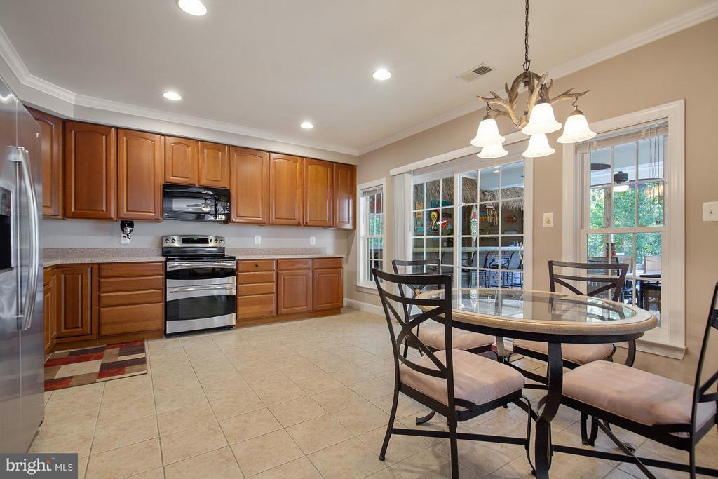 Full kitchen for apartment, leads to pool, bar. - 170 BALL RD, SAINT LEONARD
