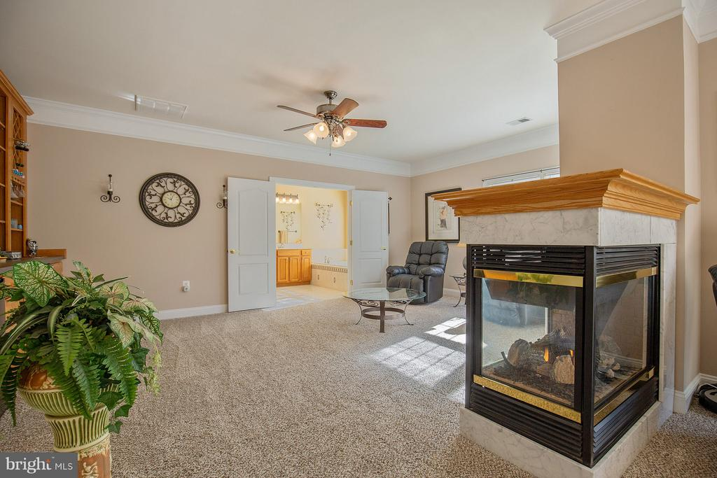 Propane fireplace, large owner's lounge. - 170 BALL RD, SAINT LEONARD