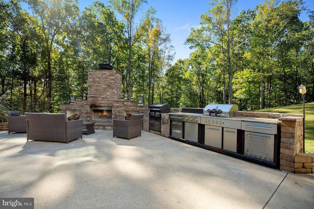 Outdoor kitchen with grill, smoker, fireplace. - 170 BALL RD, SAINT LEONARD
