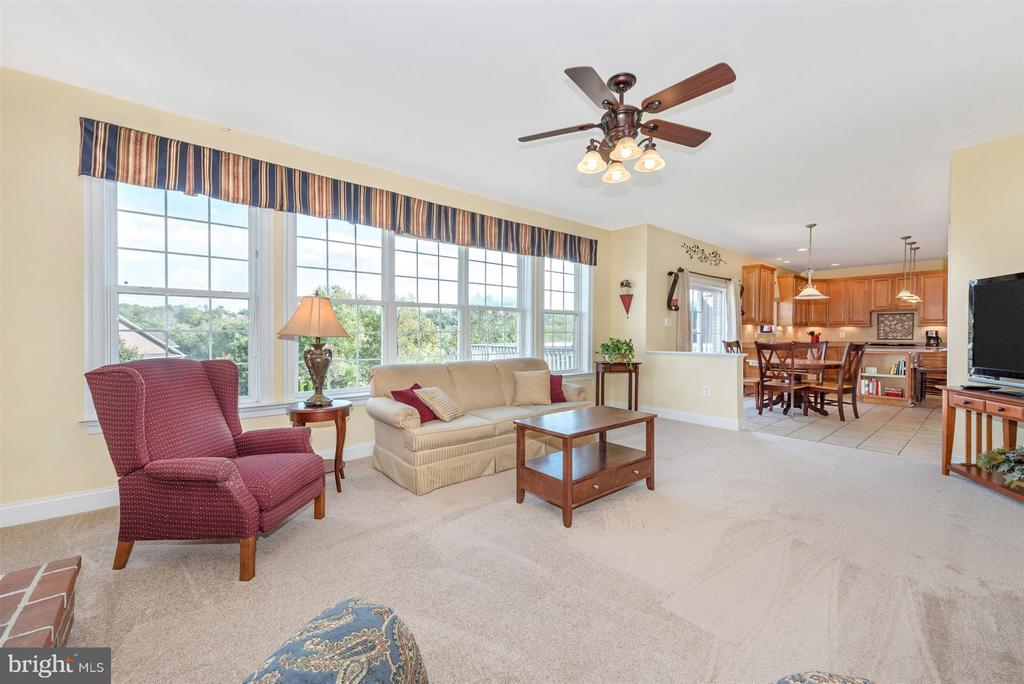 Family Room with Fireplace Open to Kitchen - 6103 RIVER VIEW CT, FREDERICK