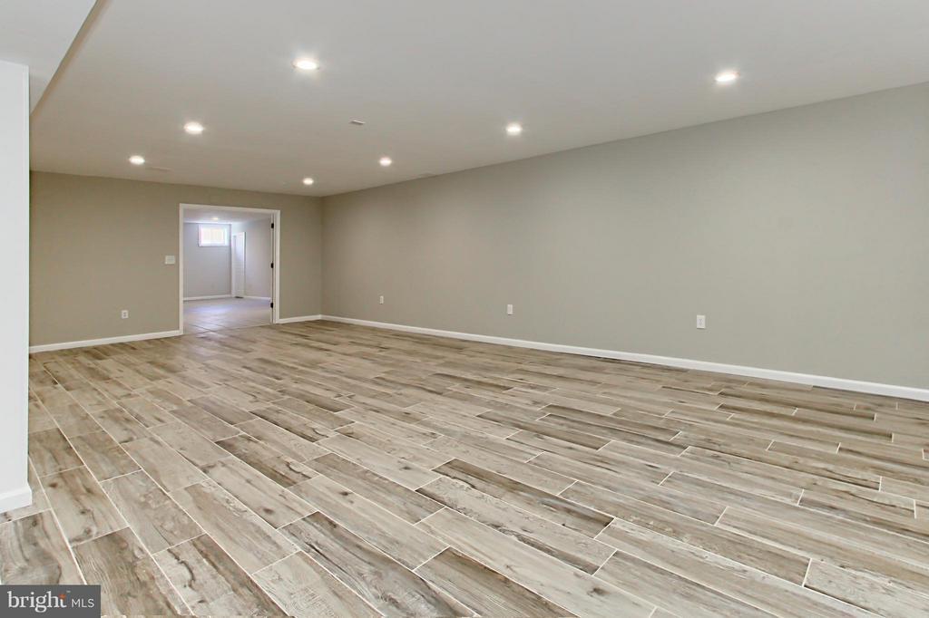 New Rec Room with Ceramic Tile Flooring - 9381 WORTHINGTON DR, BRISTOW