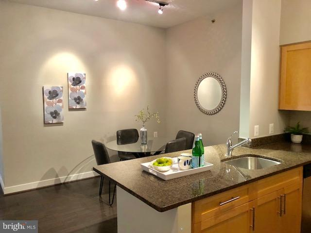 Dining area with granite countertops - 7500 WOODMONT AVE #S217, BETHESDA