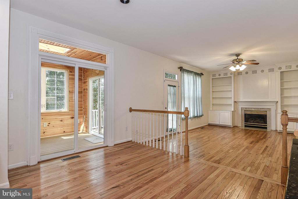 kitchen dining area/family room adjacent sunroom - 14456 SEDONA DR, GAINESVILLE