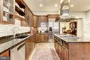 Features island w/ gas cooktop - 2121 S ST NW, WASHINGTON