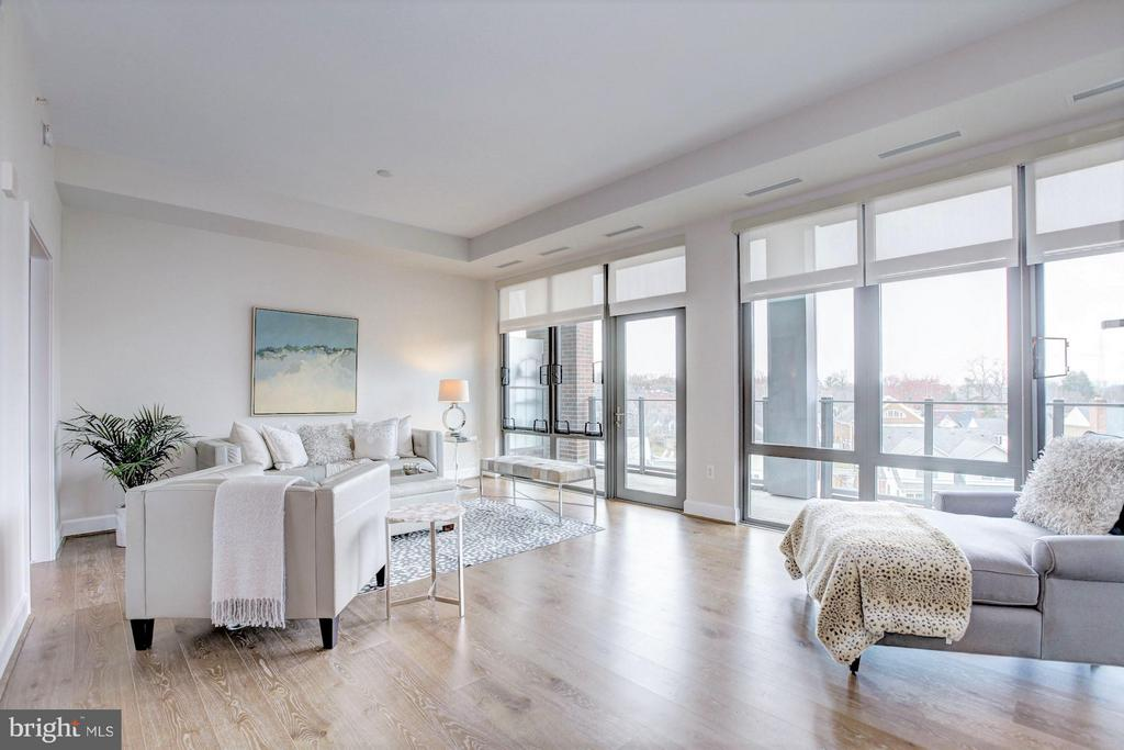 LIVING ROOM with balcony access - 7171 WOODMONT AVE #506, BETHESDA