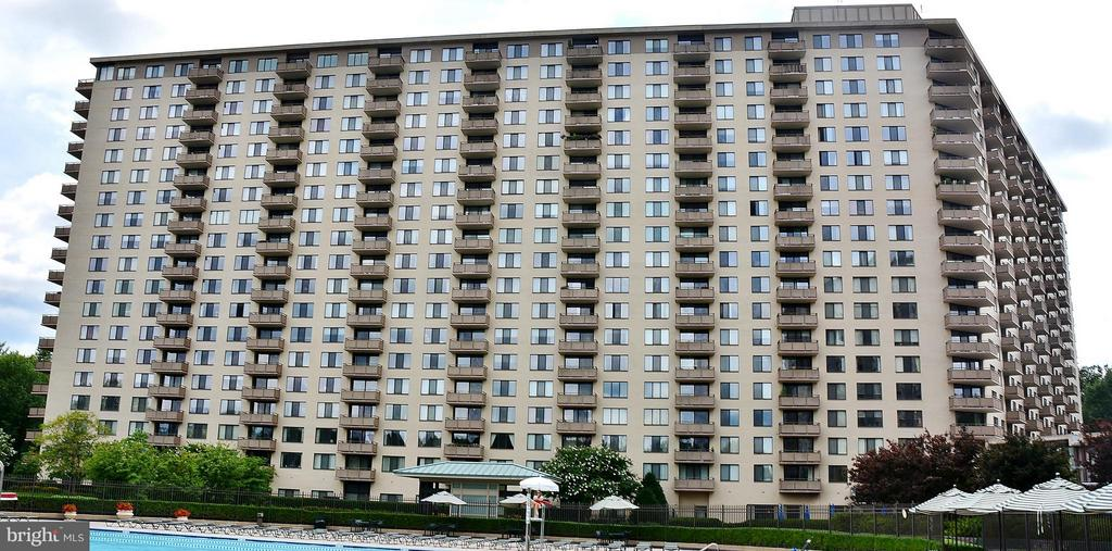 View of building from outdoor pool - 5225 POOKS HILL RD #714S, BETHESDA
