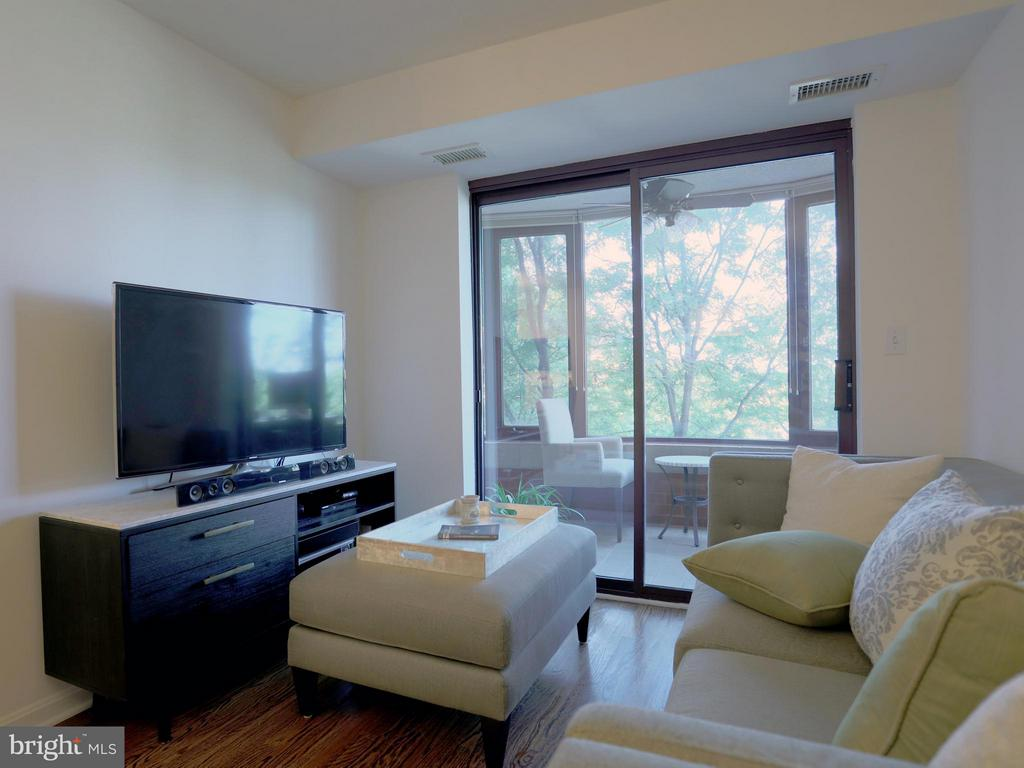 View From Living Room to Enclosed Balcony - 2400 CLARENDON BLVD #503, ARLINGTON