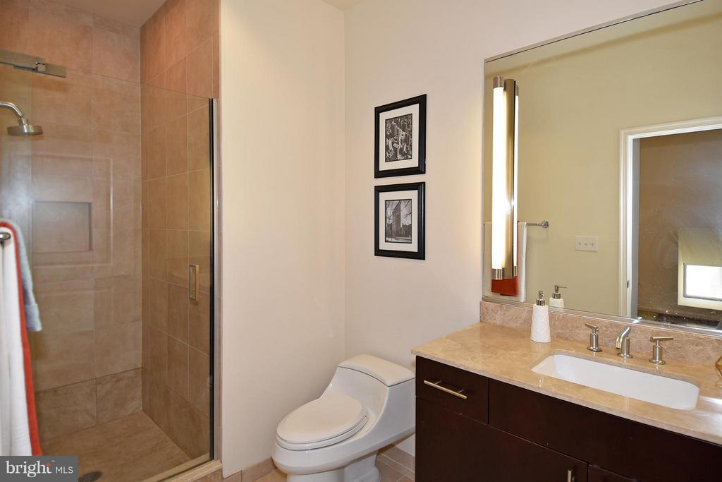 Shower with tile surround - 6500 AMERICA BLVD #204, HYATTSVILLE