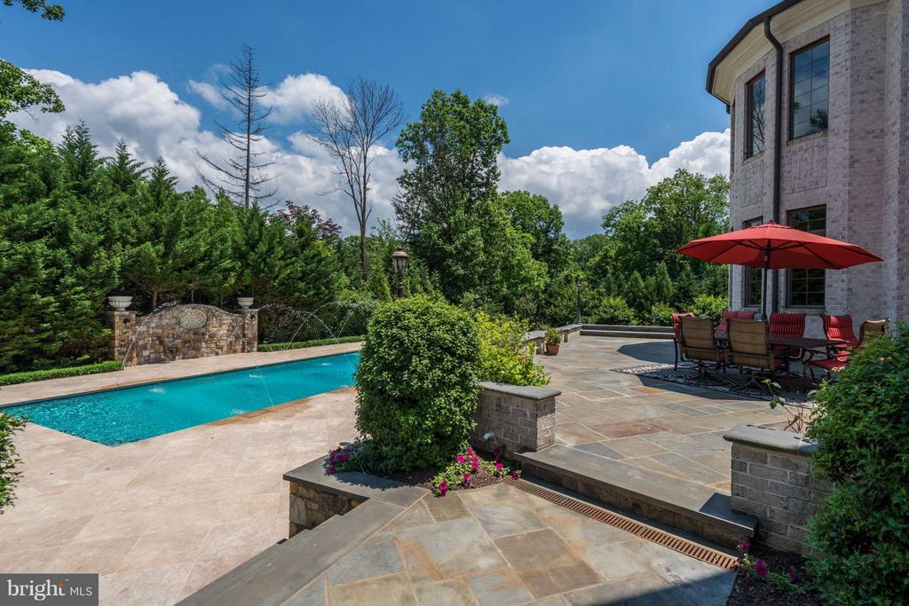 Travertine built pool deck, benches, and pool area - 8334 ALVORD ST, MCLEAN