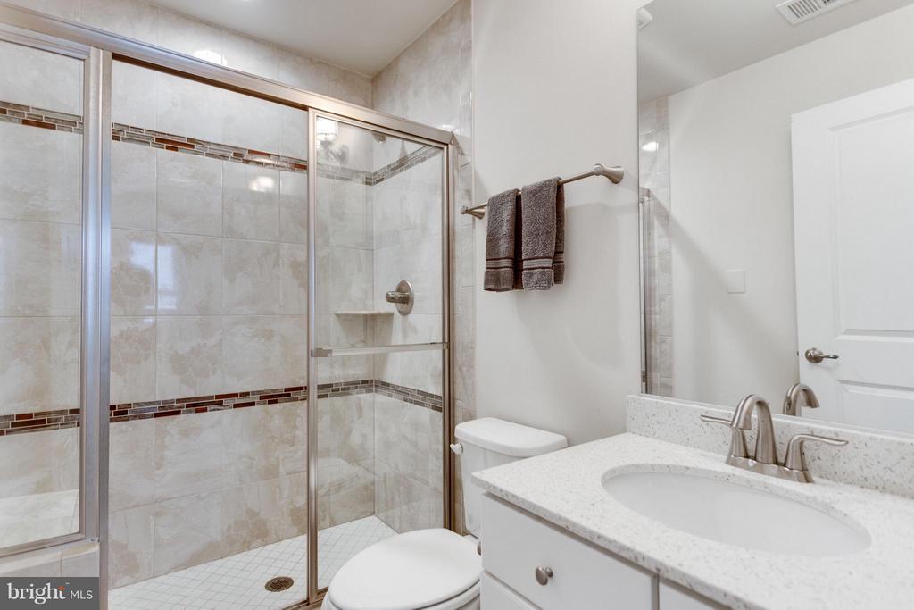 Bath #4 has lovely ceramic tile finish - 1137 MONROE ST S, ARLINGTON