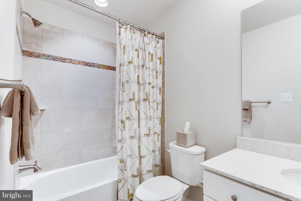 Bathroom 2 has designer tile - 1137 MONROE ST S, ARLINGTON
