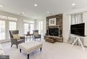 Family room with gas fireplace in lower level - 164 CROWN FARM DR, GAITHERSBURG