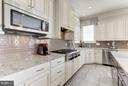 Gorgeous tile backsplash and gas stove - 164 CROWN FARM DR, GAITHERSBURG