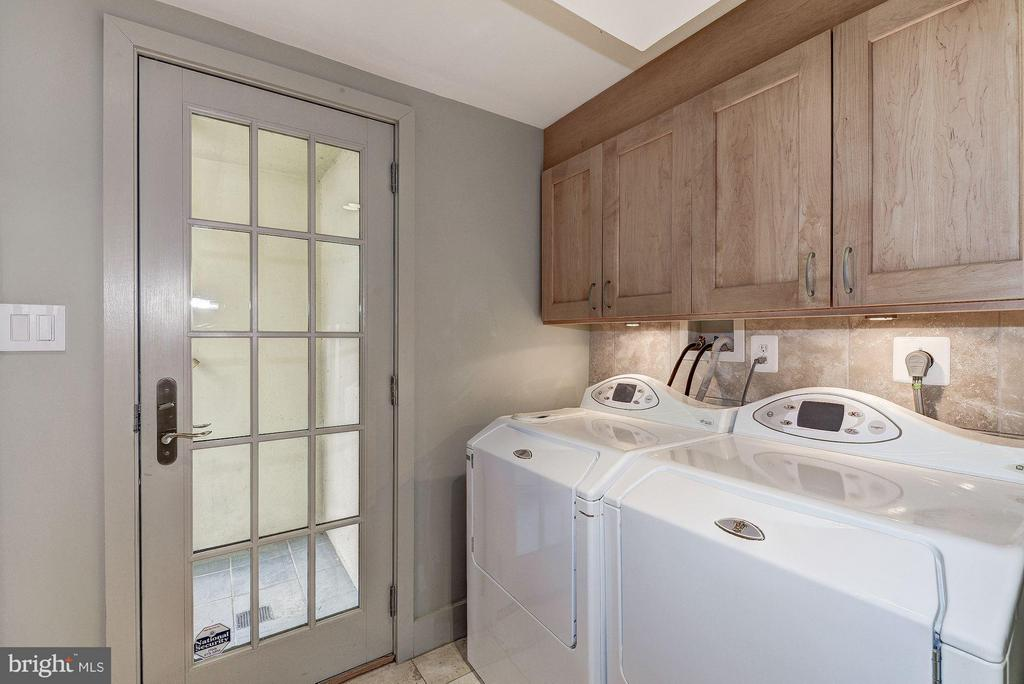 Laundry Room with Rear Exit to Outdoor Shower - 5155 ROCKWOOD PKWY NW, WASHINGTON