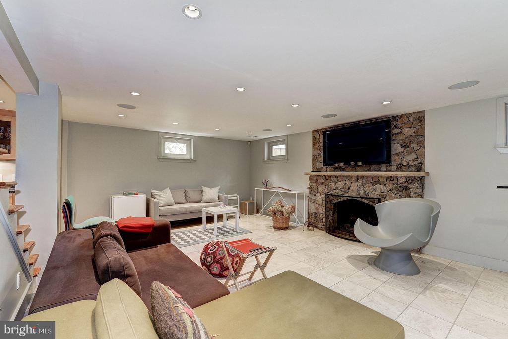 Lower Level Family Room with Stone Fireplace - 5155 ROCKWOOD PKWY NW, WASHINGTON