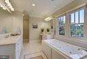 Master bath with dual vanities and  jetted tub. - 2702 24TH ST N, ARLINGTON