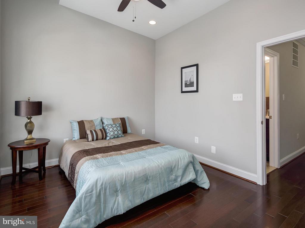 Bedroom #2 has wood floors and ceiling fan. - 1118 HOLBROOK ST NE, WASHINGTON