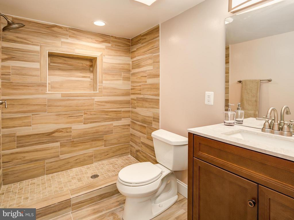Stylishly tiled basement bathroom. - 1118 HOLBROOK ST NE, WASHINGTON