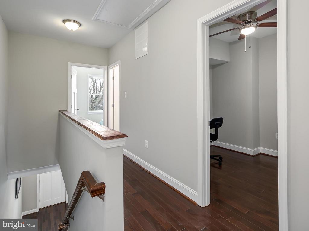 Upper Hallway leads to bedrooms. - 1118 HOLBROOK ST NE, WASHINGTON