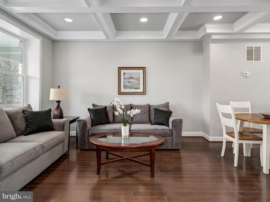 Espresso wood floors and crown molding adorn LR. - 1118 HOLBROOK ST NE, WASHINGTON