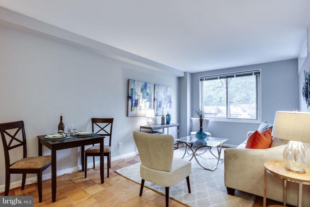 Enjoy intimate dinners in the open layout. - 5406 CONNECTICUT AVE NW #407, WASHINGTON