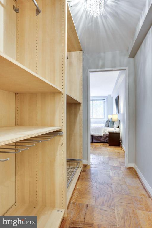 Walk-in closet/dressing room with chandelier. - 5406 CONNECTICUT AVE NW #407, WASHINGTON