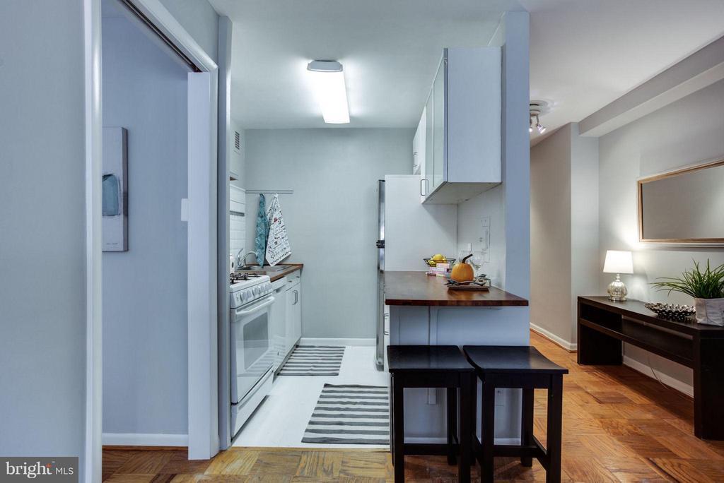 Open kitchen features a convenient breakfast bar. - 5406 CONNECTICUT AVE NW #407, WASHINGTON