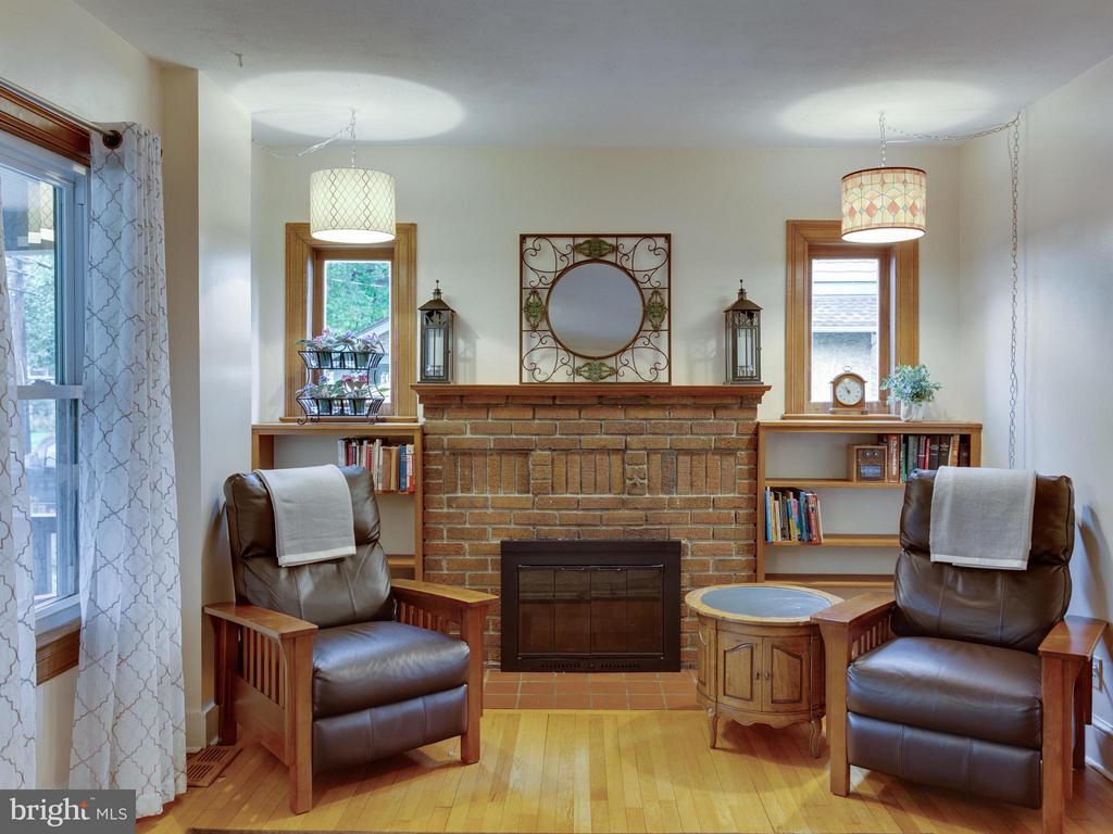 Living room with brick fireplace & bookshelves - 5601 42ND AVE, HYATTSVILLE