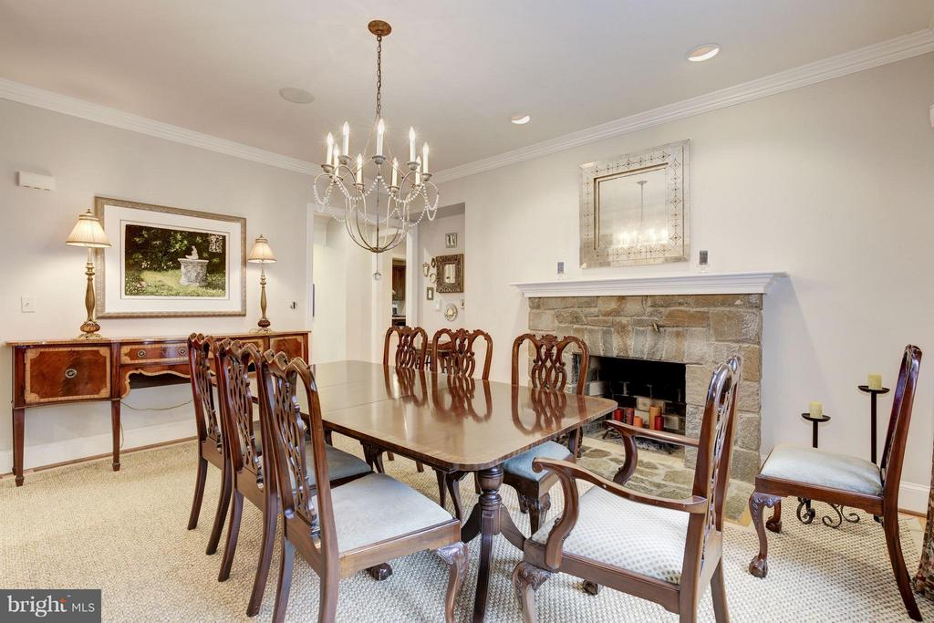Formal dining room with stone fireplace - 4949 SHERIER PL NW, WASHINGTON