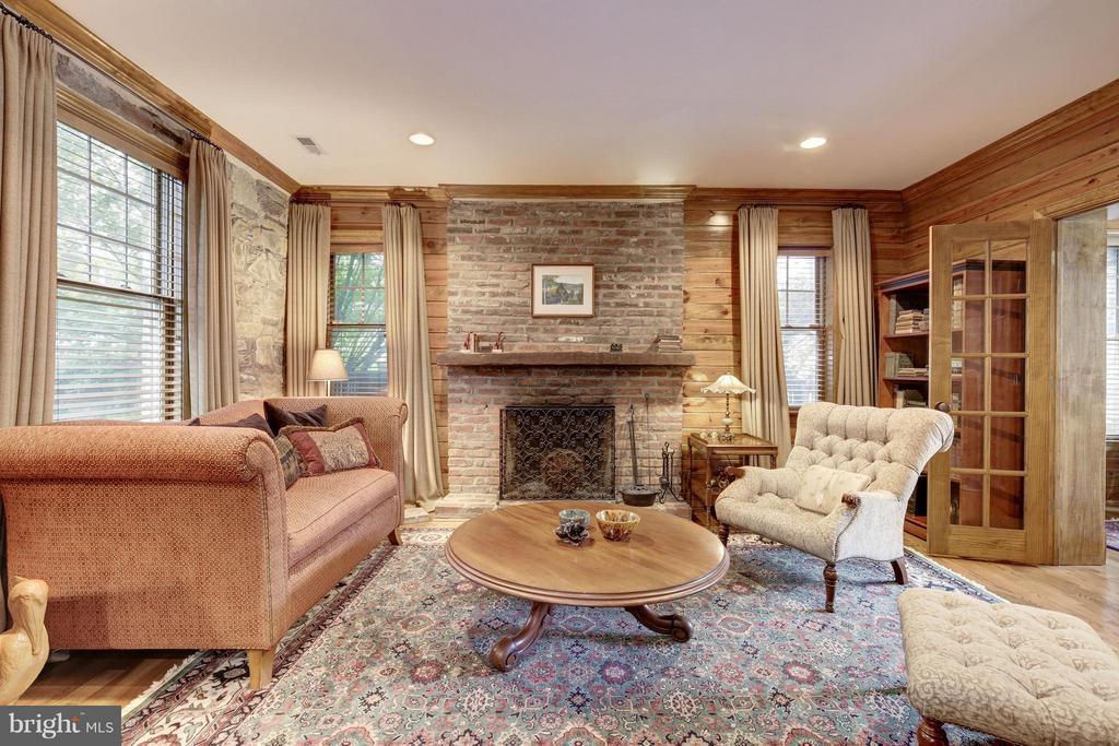 Den with original stone and wood paneled walls - 4949 SHERIER PL NW, WASHINGTON