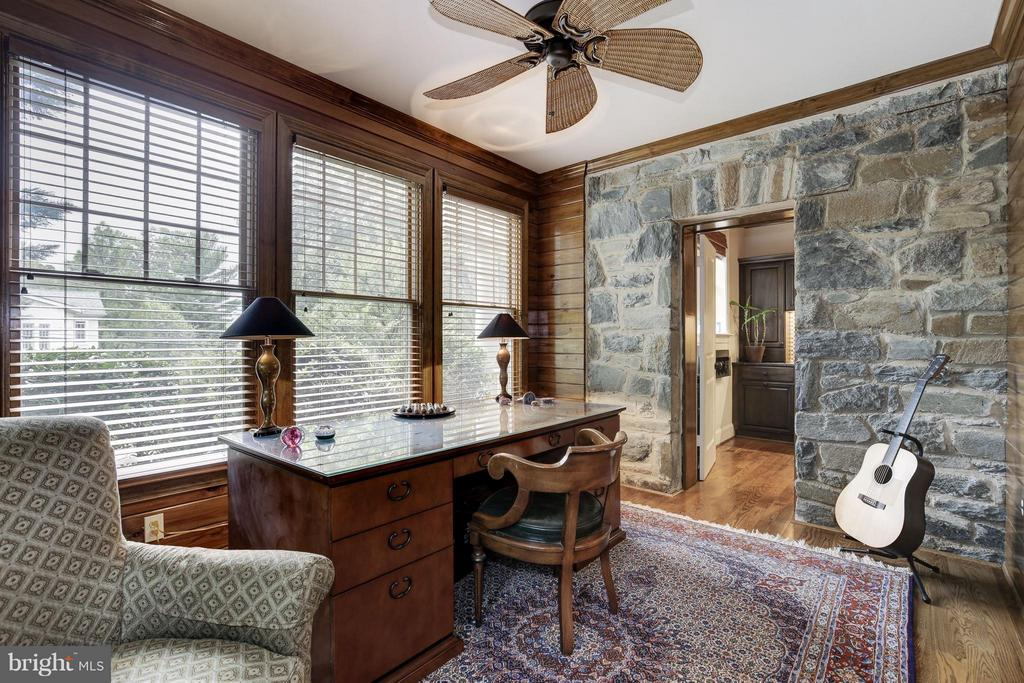 Office with exposed stone walls next to bar - 4949 SHERIER PL NW, WASHINGTON