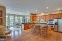 Grand Center Island in Gourmet Kitchen. - 11600 FOREST HILL CT, FAIRFAX