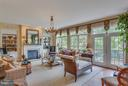 Light-Infused Family Room with Gas Fireplace. - 11600 FOREST HILL CT, FAIRFAX