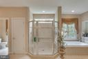 Luxurious Master Bath w 2 Private Water Closets. - 11600 FOREST HILL CT, FAIRFAX