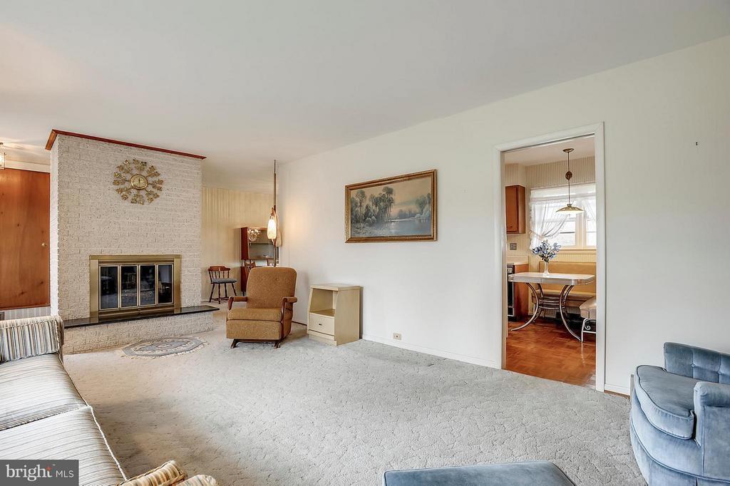 Living room has brick wood-burning FP - 15411 HERNDON AVE, CHANTILLY