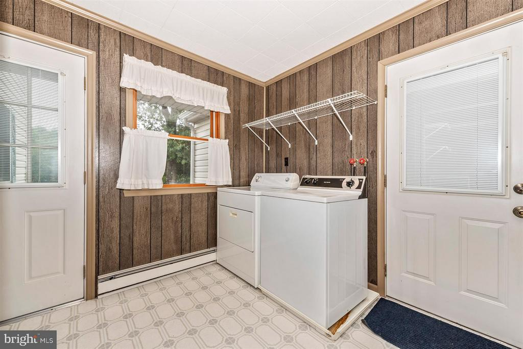 LAUNDRY ROOM OFF KITCHEN WITH ACCESS TO GARAGE - 7433 OLD WASHINGTON RD, WOODBINE