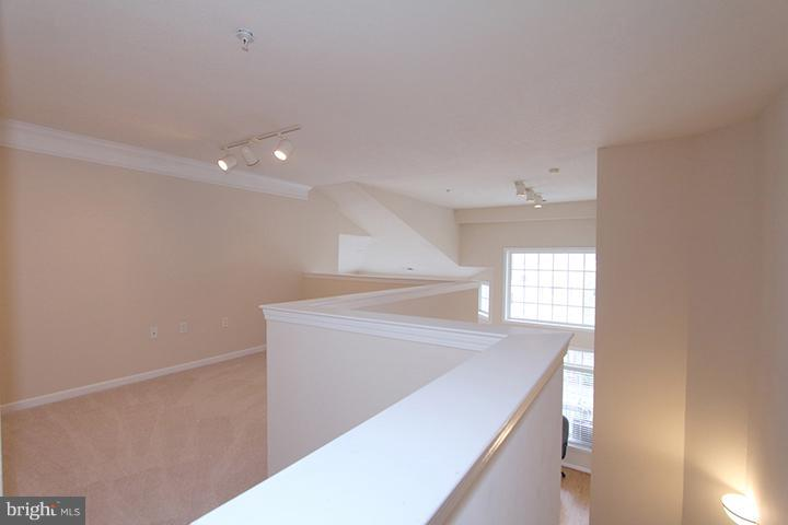 Stairs walking up to spacious loft - 507 SUNSET VIEW TER SE #308, LEESBURG