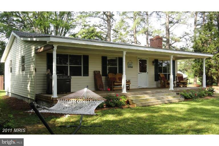 Large front porch and mature shade trees. - 186 OSPREY DR, MONTROSS