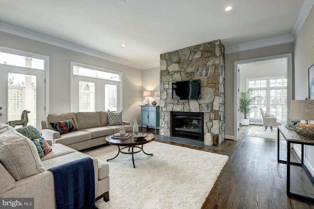 Family room with stone fireplace - 2550 VALE RIDGE CT, OAKTON